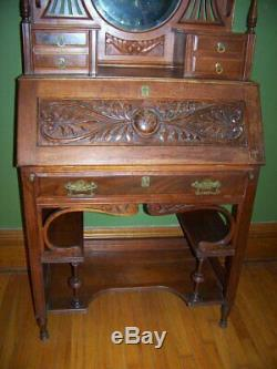 Antique Cherry desk secretary cabinet elaborate carving/turnings, bvld. Mirror