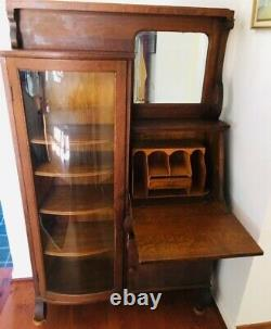 Antique solid oak side by side secretary desk with beveled mirror and curved gla