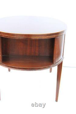 Great English Hepplewhite Inlaid Mahogany Leather Top Irwin Oval Desk, c. 1930